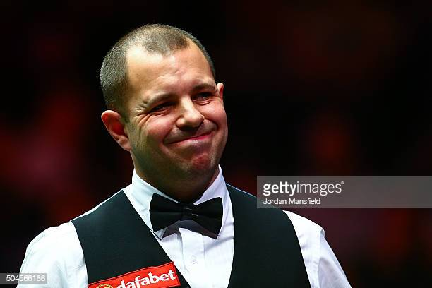 Barry Hawkins of England reacts during his first round match against Joe Perry of England during Day Two of the Dafabet Masters at Alexandra Palace...