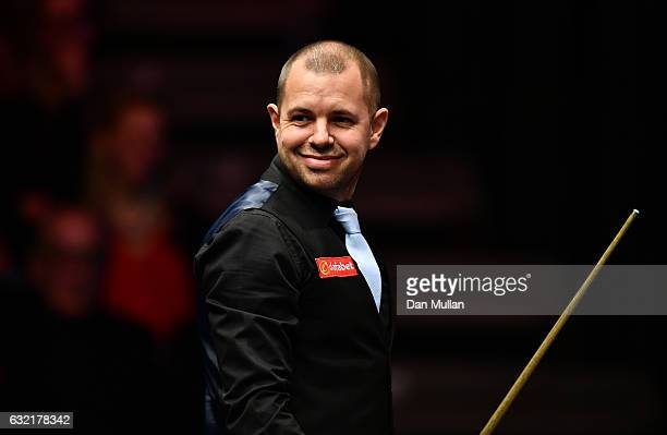 Barry Hawkins of England reacts during his quarter final match against Mark Selby of England on day six of the Dafabet Masters at Alexandra Palace on...