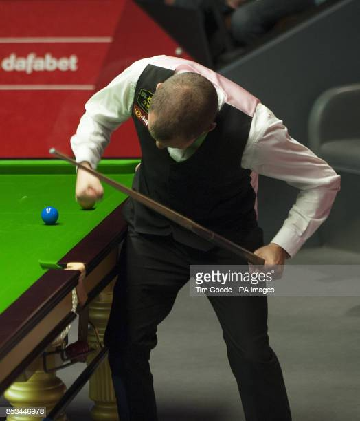Barry Hawkins punches the table as he secures the points to win the final frame over Dominic Dale during the Dafabet World Snooker Championships at...
