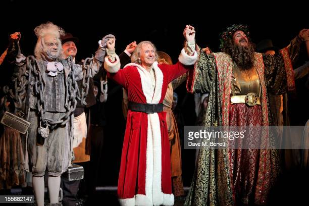 Barry Howard Tommy Steele and James Head bow at the curtain call during the press night performance of 'Scrooge The Musical' at the London Palladium...