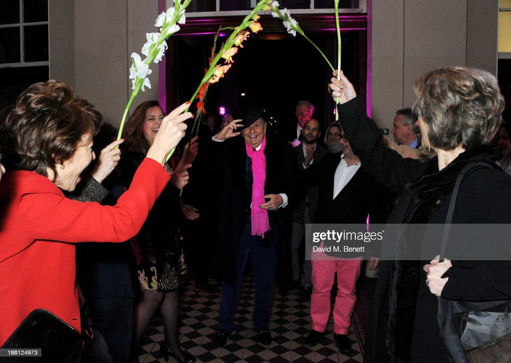<a gi-track='captionPersonalityLinkClicked' href=/galleries/search?phrase=Barry+Humphries&family=editorial&specificpeople=206650 ng-click='$event.stopPropagation()'>Barry Humphries</a> (C) arrives at an after party celebrating the press night performance of '<a gi-track='captionPersonalityLinkClicked' href=/galleries/search?phrase=Barry+Humphries&family=editorial&specificpeople=206650 ng-click='$event.stopPropagation()'>Barry Humphries</a>' Eat, Pray, Laugh!' at One Mayfair on November 15, 2013 in London, England.