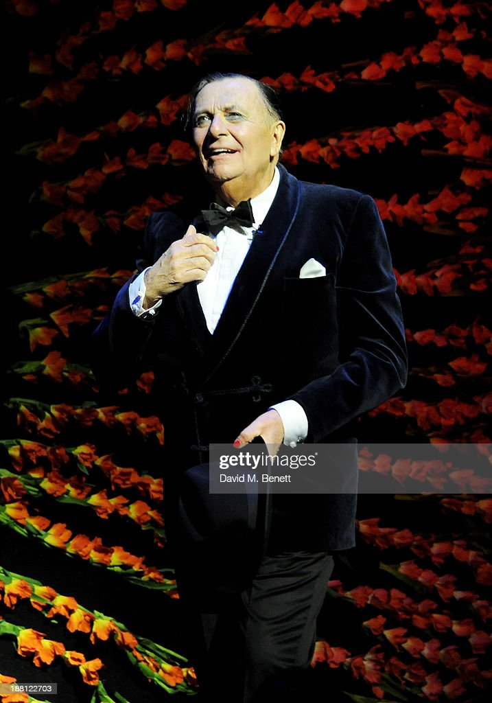 <a gi-track='captionPersonalityLinkClicked' href=/galleries/search?phrase=Barry+Humphries&family=editorial&specificpeople=206650 ng-click='$event.stopPropagation()'>Barry Humphries</a> bows at the curtain call during the press night performance of '<a gi-track='captionPersonalityLinkClicked' href=/galleries/search?phrase=Barry+Humphries&family=editorial&specificpeople=206650 ng-click='$event.stopPropagation()'>Barry Humphries</a>' Eat, Pray, Laugh!' at the London Palladium on November 15, 2013 in London, England.