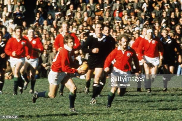 Barry John of the British Lions goes on the attack during a test match on the British Lions Tour to New Zealand in 1971