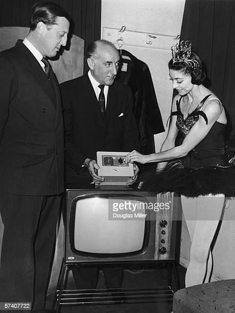 Barry King joint Managing Director of PayTV Ltd a subsidiary of British Relay Wireless demonstrates the new PayAsYouView television to ballerina...