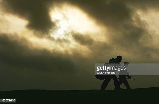 Barry Lane of England and caddie Peter coleman walk up the fairway on the 13th hole during the third round of The Estoril Open de Portugal at The...