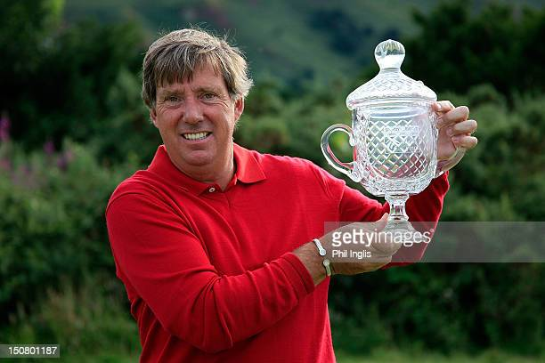 Barry Lane of England poses with the trophy after the final round of the Speedy Services Wales Senior Open played at Conwy Golf Club on August 26...