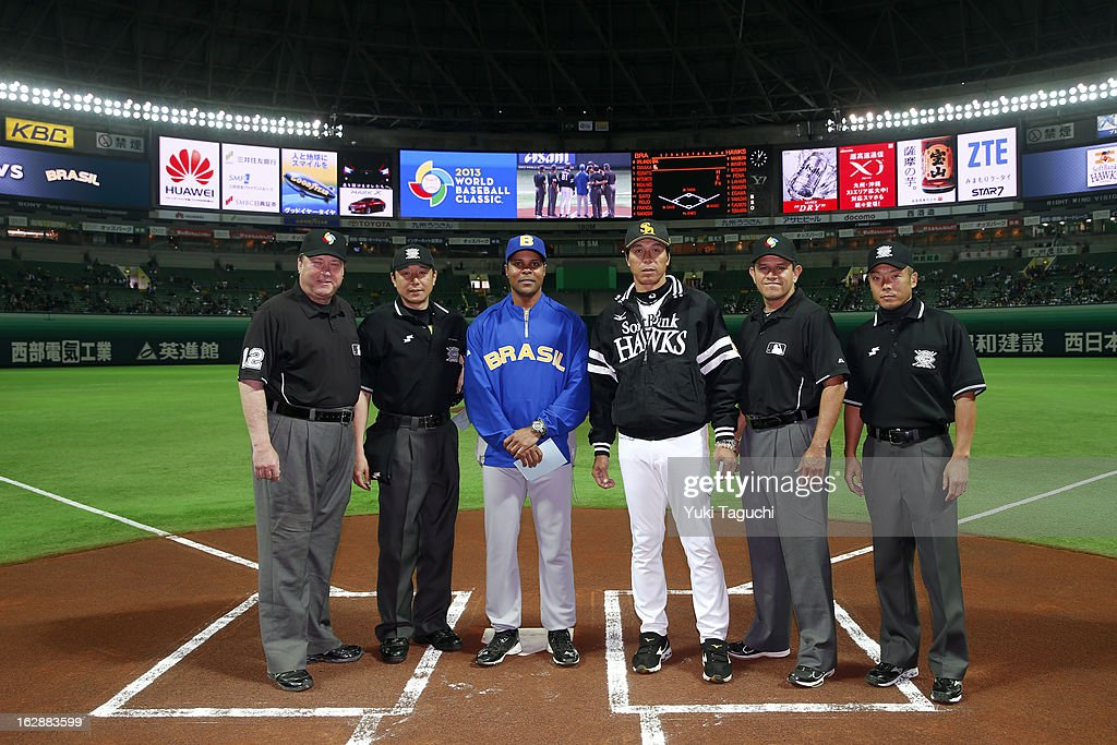 <a gi-track='captionPersonalityLinkClicked' href=/galleries/search?phrase=Barry+Larkin&family=editorial&specificpeople=204522 ng-click='$event.stopPropagation()'>Barry Larkin</a> #11 manager of Team Brazil and Koji Akiyama #81 manager of the SoftBank Hawks pose for a photo with the umpiring crew before the World Baseball Classic exhibition game against the SoftBank Hawks at the Fukuoka Yahoo! Japan Dome on Thursday, February 28, 2013 in Fukuoka, Japan.