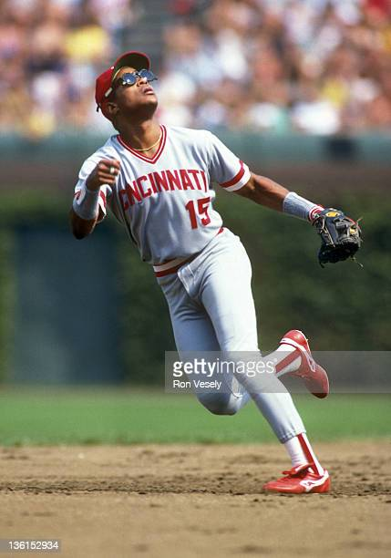 Barry Larkin of the Cincinnati Reds fields against the Chicago Cubs during an MLB game at Wrigley Field in Chicago Illinois Larkin played for the...