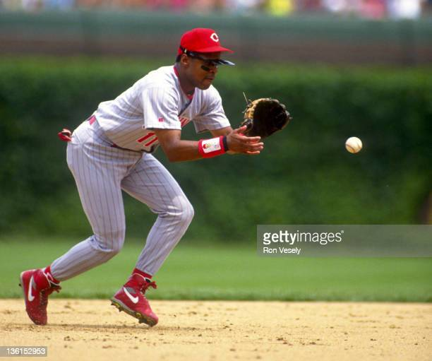 Barry Larkin of the Cincinnati Reds fields during an MLB game against the Chicago Cubs at Wrigley Field in Chicago Illinois Larkin played for the...