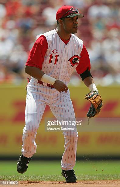 Barry Larkin of the Cincinnati Reds focuses on home plate as he prepares for a play during the interleague game against the Texas Rangers at the...