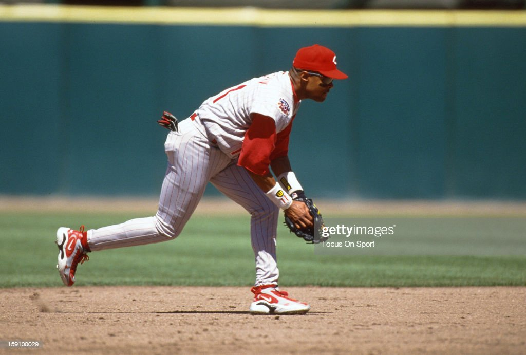 <a gi-track='captionPersonalityLinkClicked' href=/galleries/search?phrase=Barry+Larkin&family=editorial&specificpeople=204522 ng-click='$event.stopPropagation()'>Barry Larkin</a> #11 of the Cincinnati Reds goes down to field a ground ball against the San Francisco Giants during an Major League Baseball game circa 1997 at Candlestick Park in San Francisco, California. Larkin played for the Reds from 1986-04