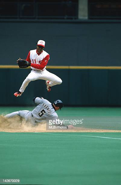 Barry Larkin of the Cincinnati Reds makes a play during a game against the Houston Astros during the 1996 regular season at Cinergy Field in...