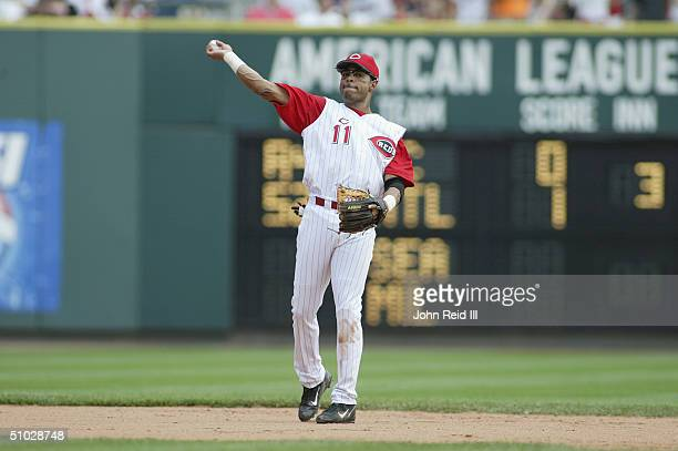 Barry Larkin of the Cincinnati Reds makes a throw during the MLB game against the Texas Rangers at Great American Ball Park on June 17 2004 in...