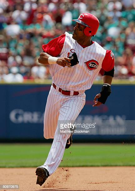 Barry Larkin of the Cincinnati Reds races to third base on a Sean Casey double in the fourth inning against the Texas Rangers June 17 2004 at the...