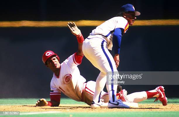 Barry Larkin of the Cincinnati Reds slides safely into second base during an MLB game at Riverfront Stadium in Cincinnati Ohio Larkin played for the...