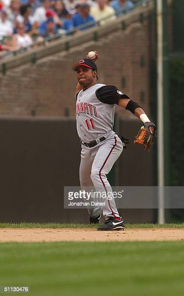 Barry Larkin of the Cincinnati Reds throws the ball against the Chicago Cubs during the game at Wrigley Field on July 21 2004 in Chicago Illinois The...