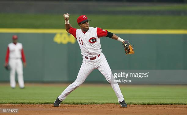 Barry Larkin of the Cincinnati Reds throws the ball to first base against the Houston Astros during the game on May 21 2004 at Great American...