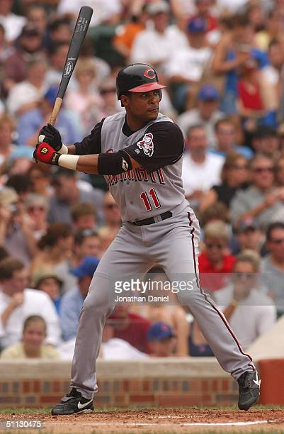 Barry Larkin of the Cincinnati Reds waits for a Chicago Cubs pitch during a game at Wrigley Field on July 21 2004 in Chicago Illinois The Cubs...
