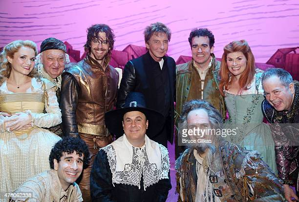Barry Man ilow poses with the cast backstage at the hit musical 'Something Rotten' on Broadway at The St James Theater June 21 2015 in New York City