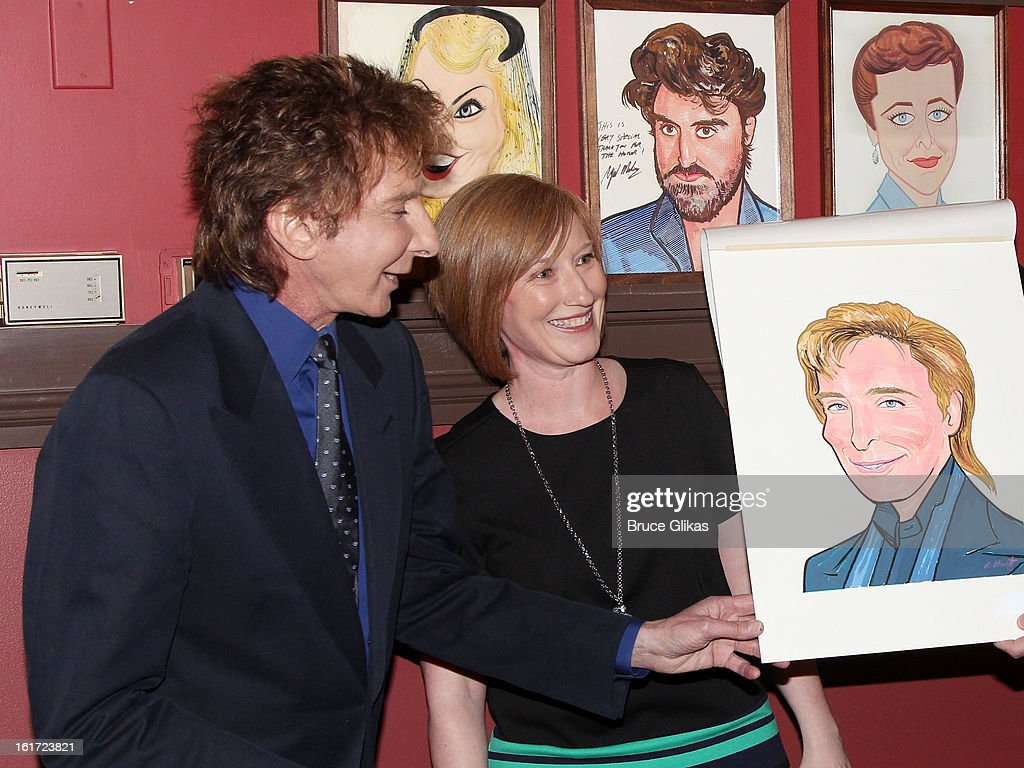Barry Manilow and American Theatre Wing Executive Director Heather Hitchens attend the Barry Manilow Caricature Unveiling at Sardi's on February 14, 2013 in New York City.
