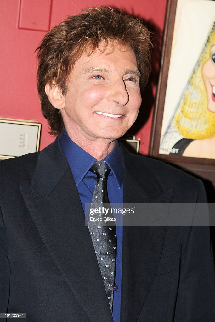 <a gi-track='captionPersonalityLinkClicked' href=/galleries/search?phrase=Barry+Manilow&family=editorial&specificpeople=210534 ng-click='$event.stopPropagation()'>Barry Manilow</a> attends his Caricature Unveiling at Sardi's on February 14, 2013 in New York City.