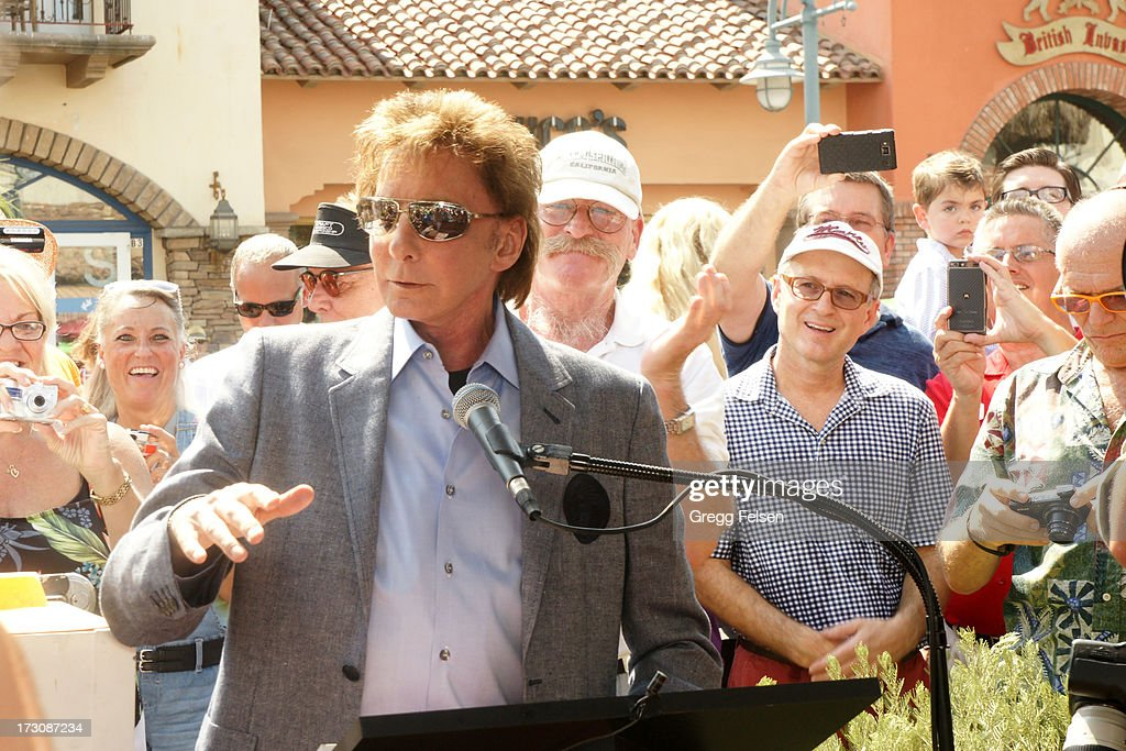 <a gi-track='captionPersonalityLinkClicked' href=/galleries/search?phrase=Barry+Manilow&family=editorial&specificpeople=210534 ng-click='$event.stopPropagation()'>Barry Manilow</a> attends Palm Springs 'Walk of Stars' ceremony for KC And The Sunshine Band on July 6, 2013 in Palm Springs, California.