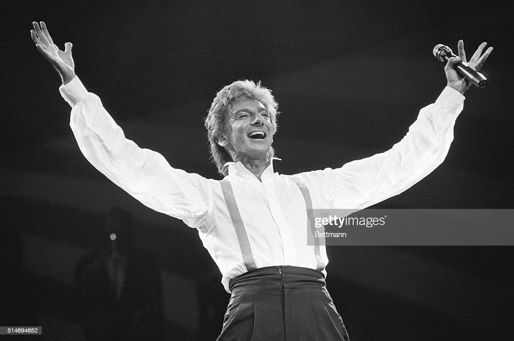 <a gi-track='captionPersonalityLinkClicked' href=/galleries/search?phrase=Barry+Manilow&family=editorial&specificpeople=210534 ng-click='$event.stopPropagation()'>Barry Manilow</a> performs at Radio City Music Hall on New Years Eve 1985.
