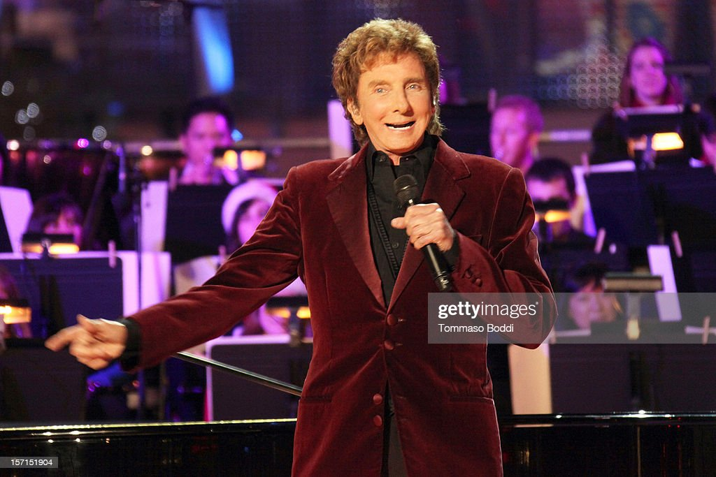 <a gi-track='captionPersonalityLinkClicked' href=/galleries/search?phrase=Barry+Manilow&family=editorial&specificpeople=210534 ng-click='$event.stopPropagation()'>Barry Manilow</a> performs at the 5th annual Holiday Tree Lighting at L.A. LIVE & opening of LA Kings Holiday Ice held at Nokia Plaza L.A. LIVE on November 28, 2012 in Los Angeles, California.