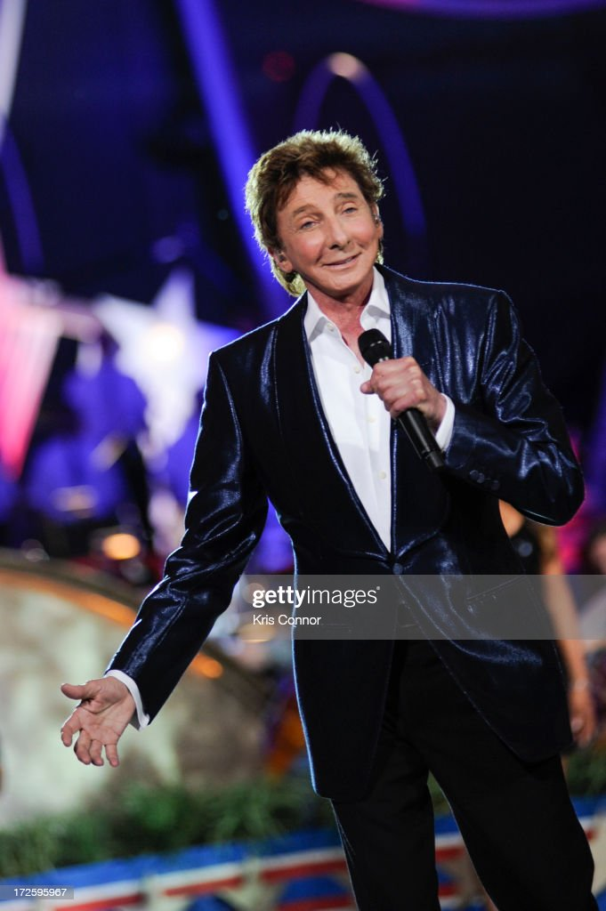 <a gi-track='captionPersonalityLinkClicked' href=/galleries/search?phrase=Barry+Manilow&family=editorial&specificpeople=210534 ng-click='$event.stopPropagation()'>Barry Manilow</a> performs during a rehearsal for the 'A Capitol Fourth 2013 Independence Day Concert' on the West Lawn of the US Capitol on July 3, 2013 in Washington, DC.