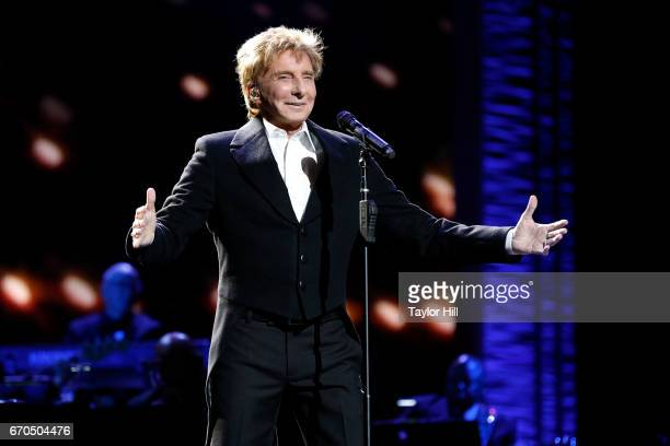 Barry Manilow performs during the 2017 Tribeca Film Festival Opening Gala premiere of 'Clive Davis The Soundtrack of our Lives' at Radio City Music...