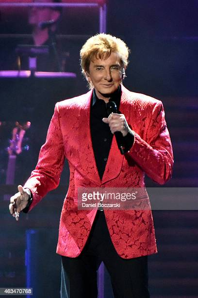 Barry Manilow performs on stage during the One Last Time Tour at United Center on February 14 2015 in Chicago Illinois
