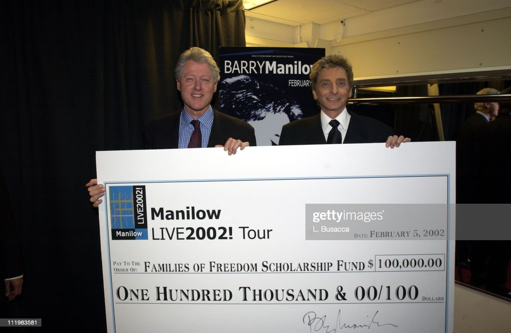 <a gi-track='captionPersonalityLinkClicked' href=/galleries/search?phrase=Barry+Manilow&family=editorial&specificpeople=210534 ng-click='$event.stopPropagation()'>Barry Manilow</a> presents former president <a gi-track='captionPersonalityLinkClicked' href=/galleries/search?phrase=Bill+Clinton&family=editorial&specificpeople=67203 ng-click='$event.stopPropagation()'>Bill Clinton</a> with a $100,000 check from the proceeds of his opening night performance at Radio City Music Hall to benefit the Families of Freedom Scholarship Fund, which was founded by <a gi-track='captionPersonalityLinkClicked' href=/galleries/search?phrase=Bill+Clinton&family=editorial&specificpeople=67203 ng-click='$event.stopPropagation()'>Bill Clinton</a> and <a gi-track='captionPersonalityLinkClicked' href=/galleries/search?phrase=Bob+Dole&family=editorial&specificpeople=118596 ng-click='$event.stopPropagation()'>Bob Dole</a> after the events of September 11th