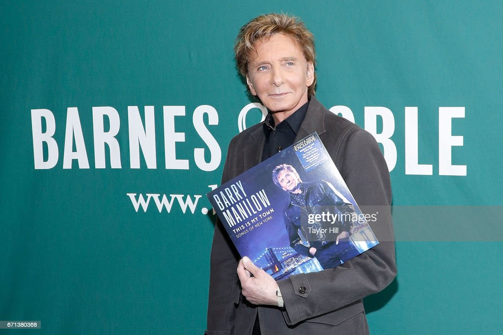 Barry Manilow signs an album at Barnes & Noble Union Square on April 21, 2017 in New York City.