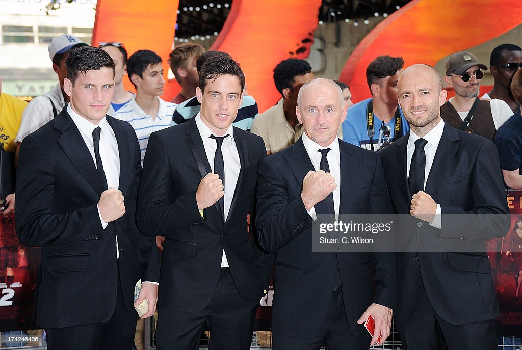 Barry McGuigan (2nd from R) and guests attends the European Premiere of 'Red 2' at Empire Leicester Square on July 22, 2013 in London, England.