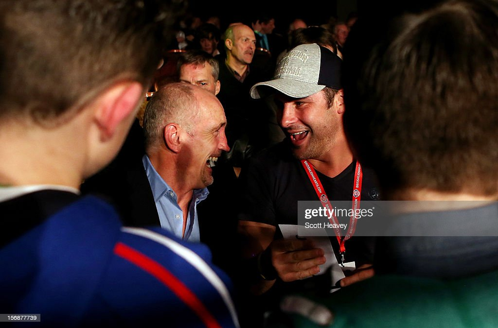 Barry McGuigan and Joe Calzaghe enjoy a joke whilst signing autographs during the World Series of Boxing between British Lionhearts and Italia Thunder on November 23, 2012 in Newport, Wales.