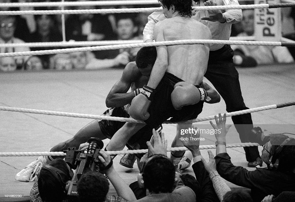 Barry McGuigan of Northern Ireland has Danilo Cabrera of the Dominican Republic fall onto him at the end of the WBA World Featherweight Championship fight held in Dublin, Ireland on the 15th February 1986. Barry McGuigan won the fight in the 14th Round.