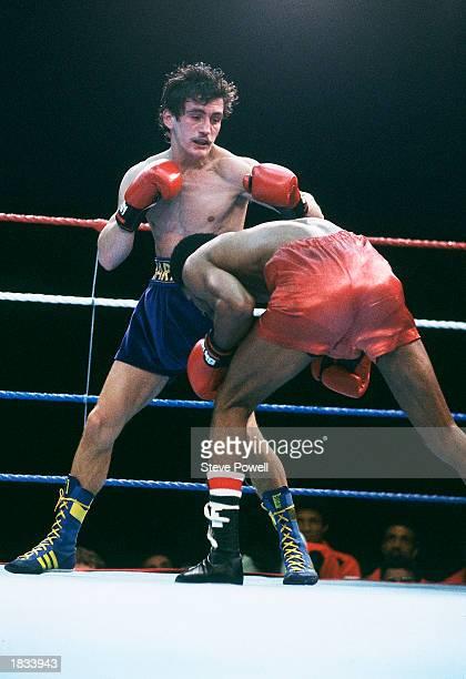 Barry McGuigan of Northern Ireland in action against WBA Champion Eusebio Pedroza of Panama at Loftus Road StadiumLondon on the 8th of June 1985...