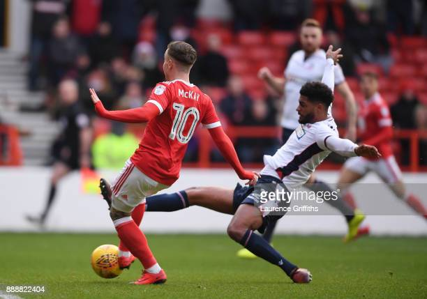 Barry McKay of Nottingham Forest scores under pressure from Mark Little of Bolton Wanderers the opening goal during the Sky Bet Championship match...