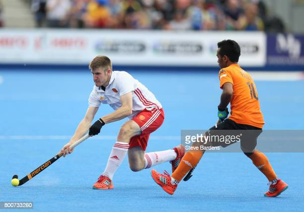 Barry Middleton of England and Faizal Saari of Malaysia battle for possession during the 3rd/4th place match between Malaysia and England on day nine...