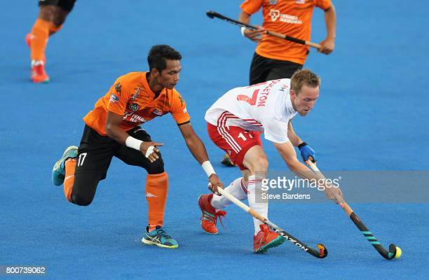 Barry Middleton of England and Razie Rahim of Malaysia battle for possession during the 3rd/4th place match between Malaysia and England on day nine...