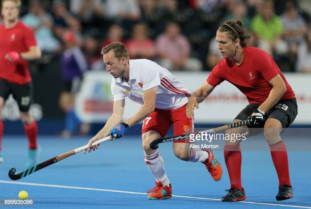 Barry Middleton of England and Taylor Curran of Canada battle for possesion during the quarter final match between England and Canada on day seven of...