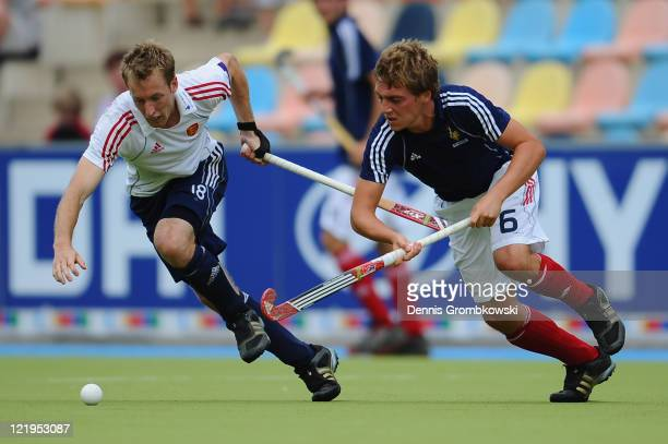 Barry Middleton of England and Tom Genestet of France battle for the ball during the Men´s EuroHockey Championships 2011 Pool B match between France...