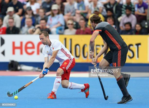 Barry Middleton of England attempts a shot at goal during the semifinal match between England and the Netherlands on day eight of the Hero Hockey...