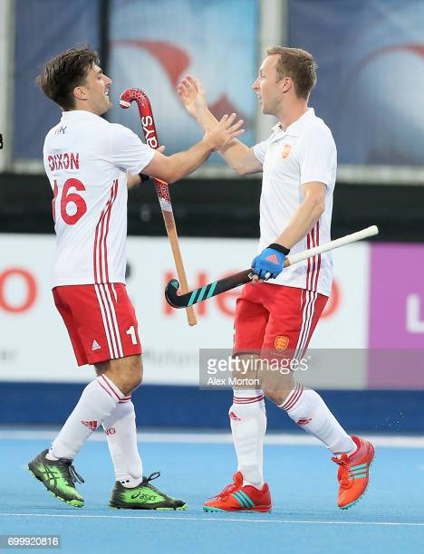 Barry Middleton of England celebrates scoring his teams first goal with teammate Adam Dixon during the quarter final match between England and Canada...