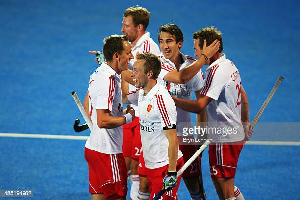 Barry Middleton of England celebrates with his team after scoring during the match between England and Spain on day five of the Unibet EuroHockey...