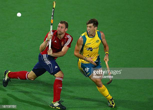 Barry Middleton of England controls the ball as he is chased by Jacob Whetton of Australia during the match between Australia and England on day four...