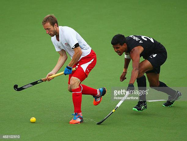 Barry Middleton of England evades of New Zealand in the bronze medal match between New Zealand and England at Glasgow National Hockey Centre during...
