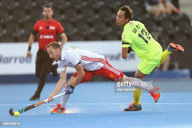 Barry Middleton of England is fouled by Fenghui Lu of China during the Hero Hockey World League Semi Final match between England and China at Lee...