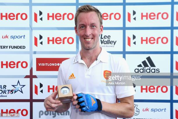 Barry Middleton of England is presented with an award for becoming the most capped England player during the Hero Hockey World League Semi Final...