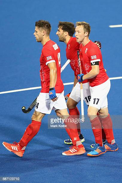 Barry Middleton of Great Britain celebrates with his team mates after scoring a goal during the men's pool A match between Great Britain and New...